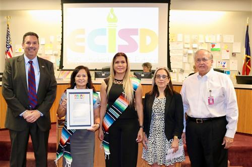 Reps from Hispanic Heritage of Odessa pose with proclamation.